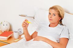 Wife is sick in bed Stock Photo