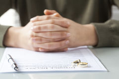Wife signs divorce decree form with ring Stock Images