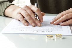Wife signs divorce decree form with ring Royalty Free Stock Images