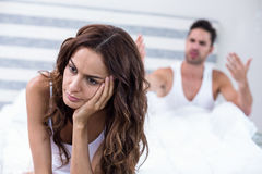 Wife sitting while husband shouting at her Stock Image