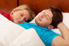 Wife sleeping next his husband Royalty Free Stock Photography