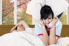 Wife with a snoring husband Stock Photography