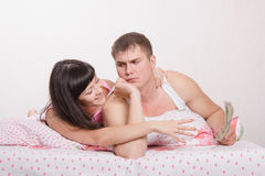 Wife suck up to her husband Royalty Free Stock Photos