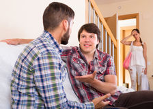 Wife suspecting her partner having affair. Wife watching partner having double talk with male friend Stock Photos