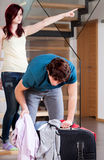Wife throwing away husband from home Royalty Free Stock Photos