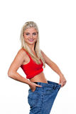 Wife to a successful diet with large pants Royalty Free Stock Photo