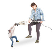 Wife vacuuming her husband Stock Image