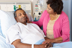 Wife Visiting Husband On Ward Royalty Free Stock Image