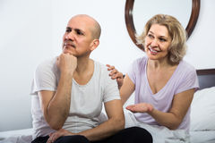 Wife warmly comforting upset husband in bedroom Royalty Free Stock Photography