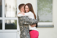 Wife Welcoming Her Husband Royalty Free Stock Images