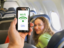 Wifi on the airplane. Hand holding mobile smart phone with connect wifi on the airplane Stock Photography