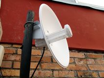 Wifi antenna mounted outdoors on the pole stock photography