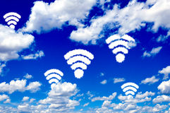 WiFi clouds. Wifi shape sign on clear blue sky Stock Photo