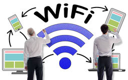Wifi concept drawn by businessmen. Wifi concept drawn on a white wall by businessmen Royalty Free Stock Photo