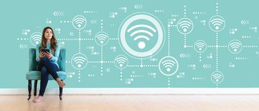Wifi concept with young woman royalty free stock images