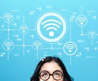 Wifi concept with young woman. Wearing eye glasses royalty free stock photo