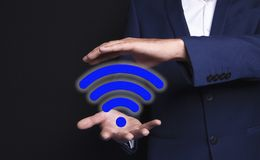 Wifi in the hands of a businessman stock images