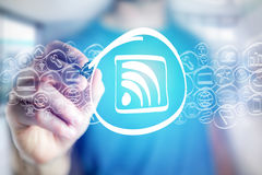 Wifi icon being drawn by a man on a virtual interface - technolo Stock Image