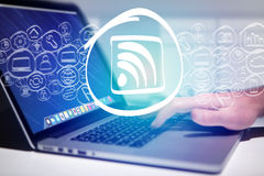 Wifi icon going out a laptop interface - technology concept Stock Images