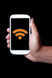 Wifi. Icon showing on smartphone Stock Photography