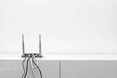 Wifi internet router on shelf in white interior Royalty Free Stock Images