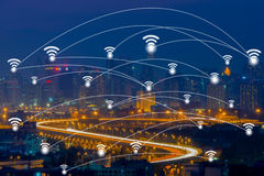 Wifi network connection concept on aerial view of cityscape busi. Ness district at twilight background Stock Photo