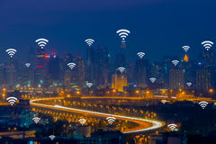 Wifi network connection concept on aerial view of cityscape busi. Ness district at twilight background Royalty Free Stock Image