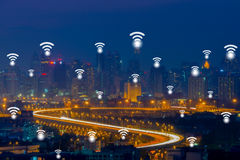 Wifi network connection concept on aerial view of cityscape busi. Ness district at twilight background Stock Images