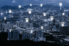 Wifi network connection concept on blue tone Hong Kong cityscape. Background and network connection concept - Network business conection system Royalty Free Stock Image