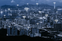 Wifi network connection concept on blue tone Hong Kong cityscape. Background and network connection concept - Network business conection system Royalty Free Stock Photography