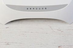 Wifi router white. With signs of connection on table Stock Photography