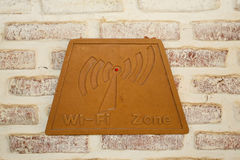 Wifi sign on brick Stock Photography