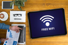 WIFI SIGNAL connectivity concept: Free wifi area sign. Thoughtful male person looking to the digital tablet screen, laptop screen,Silhouette and filter sun royalty free stock photo