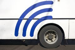 Wifi signal sign on the white bus. Blue wifi signal sign on the white bus Royalty Free Stock Images
