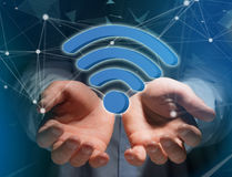 Wifi symbol displayed on a futuristic interface - Connection and Stock Photography