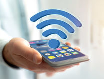 Wifi symbol displayed on a futuristic interface - Connection and Stock Photo