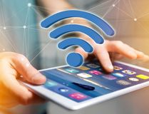 Wifi symbol displayed on a futuristic interface - Connection and Stock Images
