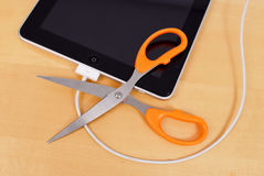 Wifi Sync on iOS 5 for the iPad. Apple Brand IPad With Scissors Cutting USB For WIFI Sync Technology On iOS 5 Stock Image