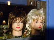 Wig dummies 3. Strange mannequins, dirty broken shop window Stock Image