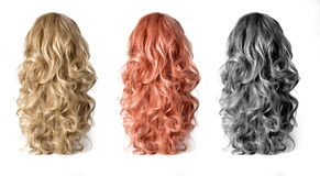 Wig of long  hair. Set  of long Wigs hair isolated on white Stock Photo