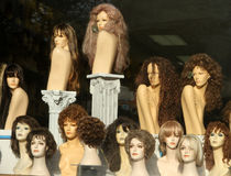 Wig Shop Window Display. A window display of mannequins wearing wigs Stock Images