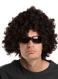 Wig and sunnies. Man with a black curly wig and sunglasses Royalty Free Stock Photos
