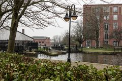 Wigan and the Canal with grey skies. A view over central Wigan on the Leeds Liverpool canal near Wigan Pier Stock Images