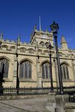 Wigan parish church. With 2 old style lampposts and wrought iron fence in foreground Stock Images