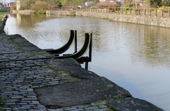 Wigan Pier and Towpath. The short and historic Wigan Pier next to the cobbled towpath that runs alongside it on the Leeds Liverpool canal Stock Photo