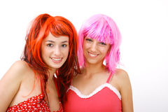 Wigged Portrait. Portrait of two young women friends wearing vivid color wigs Stock Images