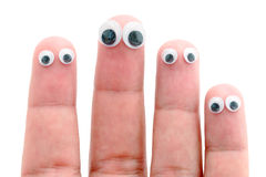 Wiggle eyes stuck on fingers. Sticky wiggle eyes stuck on four fingers isolated against a white background Royalty Free Stock Photography