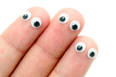 Wiggle eyes stuck on fingers Stock Images
