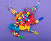 Wiggles and Wafers Bird Toy for all kind of birds, Parrots. Prevents Bird Boredom. Wiggles and Wafers Bird Toy for all kind of birds, including Parrots royalty free stock image