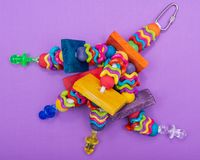 Wiggles and Wafers Bird Toy for all kind of birds, Parrots. Prevents Bird Boredom. Wiggles and Wafers Bird Toy for all kind of birds, including Parrots stock photos